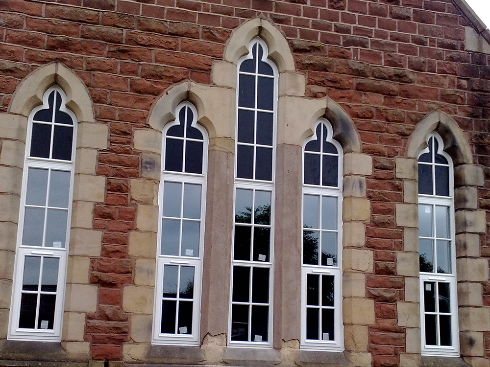arched timber windows and frames from AJ&D Chapelhow (Cliburn) Ltd