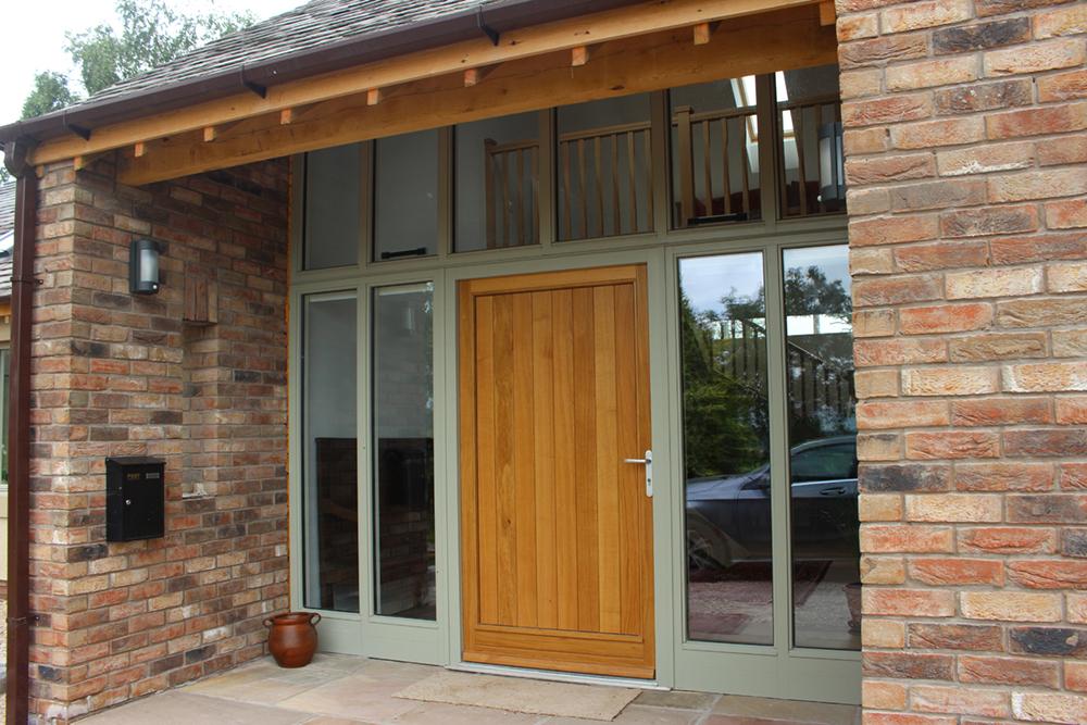 oak front door with aluminium clad side lights